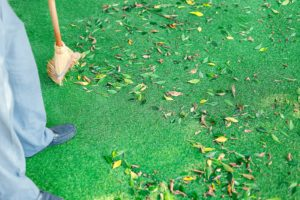 sweeping synthetic grass