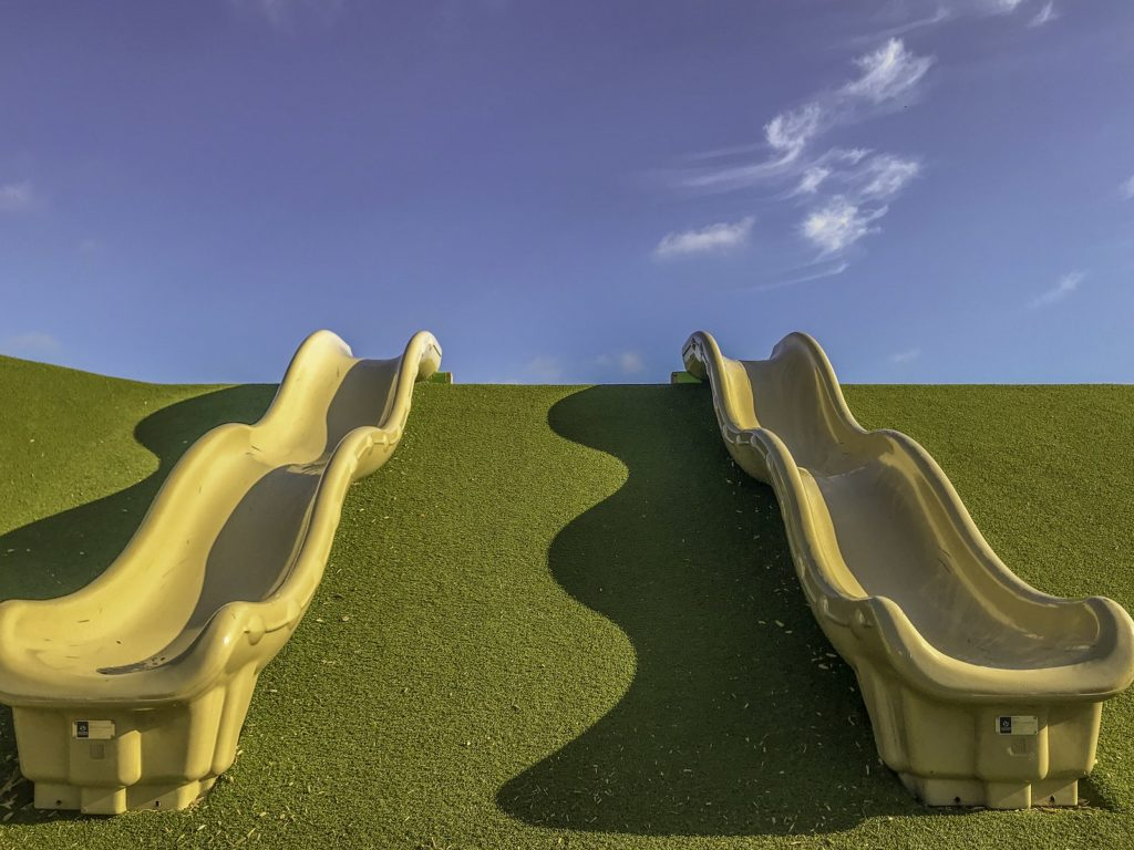 slide playground with turf