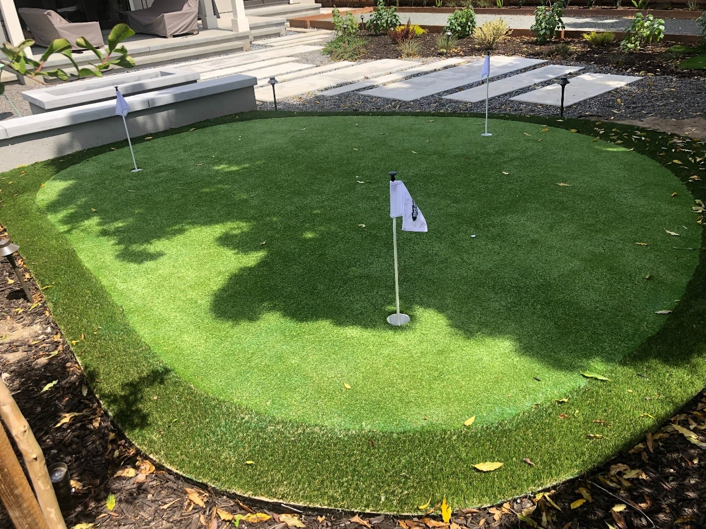 small home backyard putting green installation