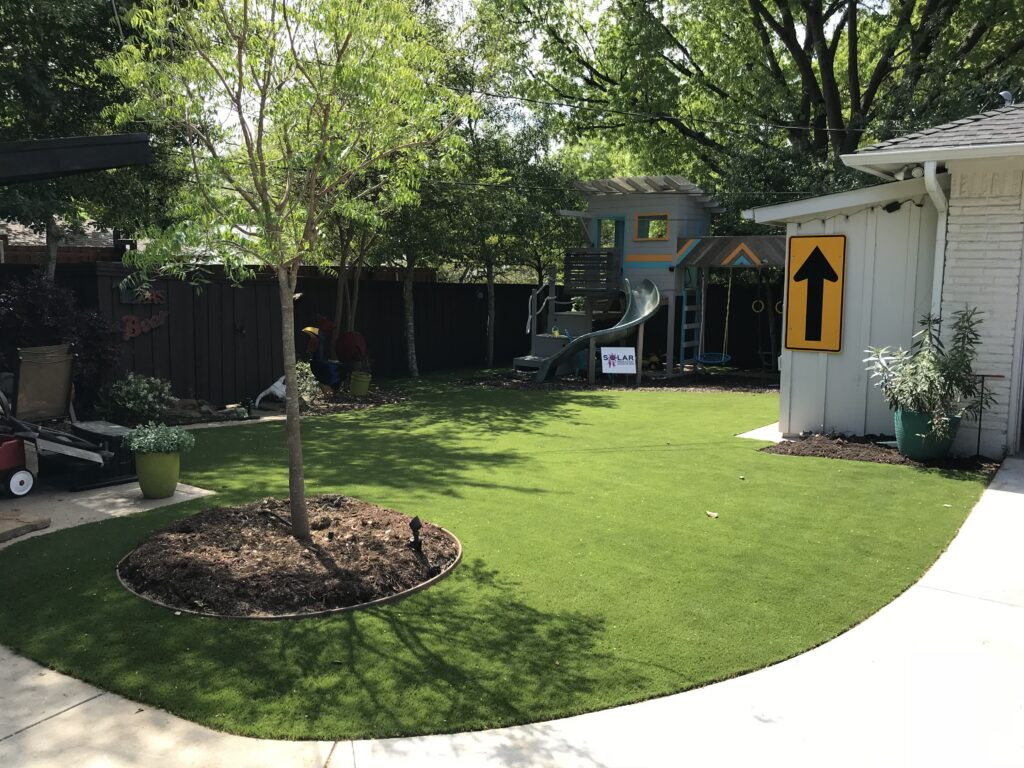 Backyard Landscaping with Playground Turf Installation